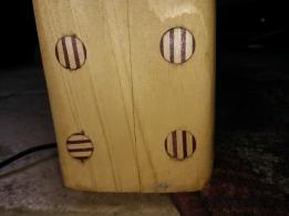 Laminate inlay bolt covers