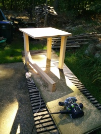 Horizontal Leg Table unifinished on louinger
